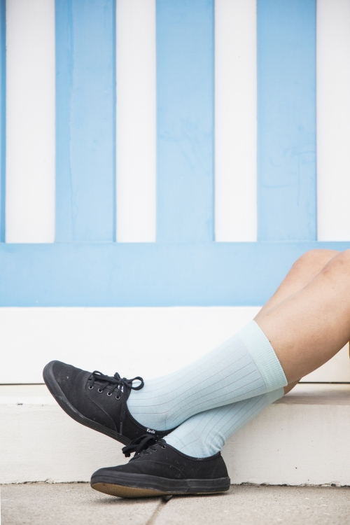 light blue socks with pink stripes